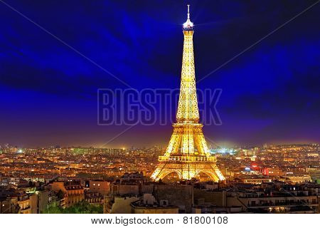 Monument was built in 1889 night view Triumphal Arch ** Note: Soft Focus at 100%, best at smaller sizes, PARIS - SEPTEMBER 20: Light Performance Show on September 20 2013 in Paris. The Eiffel Tower stands 324 metres (1063 ft) tall. Monument was built in 1889 night view Triumphal Arch ** Note: Soft Focus at 100%, best at smaller sizes
