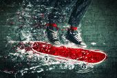 picture of skateboarding  - Urban Skateboarder jumping on doodle sketched skate board - JPG