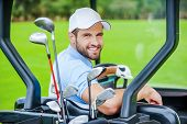 Golfer In Golf Cart.