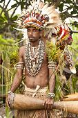 Young tribe warrior in Papua New Guinea village