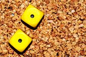 Yellow Dices One One On Cork