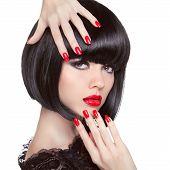 Beauty Fashion Brunette Model Portrait. Manicured Nails. Red Lips. Professional Makeup. Bob Hairstyl