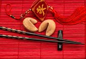 Asia Style Background With Lucky Charm, Fortune Cookies And Black Chopsticks