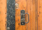 Close up of a door latch.