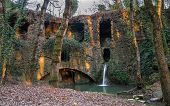 stock photo of water-mill  - Ruins of a water mill in Tuscany with a waterfall that passes through - JPG