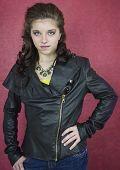 Pretty teenage girl in black leather jacket