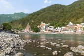 stock photo of gang  - The town of Rishikesh on the Ganges river - JPG