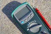 picture of  multimeter  - the Digital multimeter under a bright sunlight - JPG