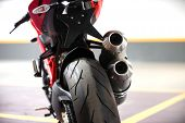 pic of exhaust pipes  - Photo of a Motorcycle parking in garage - JPG