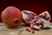 Pomegranates On A Wooden Table