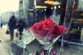Red Candles In The Form Of Hearts In The Glass In The Window