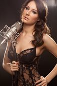 Picture Of Woman In Black With Microphone