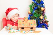 stock photo of desert christmas  - Smiling boy in Santa - JPG