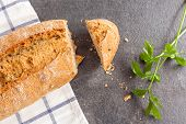Tasty Bread Sliced On Kitchen Towel
