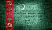 Turkmenistan flag on burlap fabric