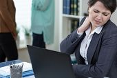 picture of muscle pain  - Office worker suffering from painful tense neck muscles - JPG