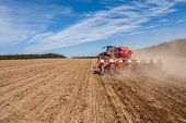 picture of plowing  - Sowing and plowing action in the spring season