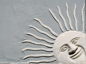 image of peer  - architectural element smiling and peering Sun on wall - JPG