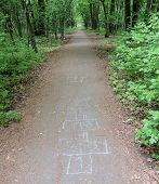 image of hopscotch  - A chalk hopscotch on a park footpath - JPG