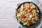 picture of caesar salad  - Delicious Caesar salad with shrimps on a black plate - JPG
