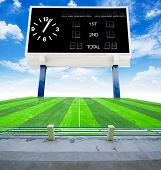 pic of grandstand  - Old black score board in field soccer with blue sky view from stadium - JPG