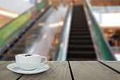 stock photo of escalator  - Defocus and Blur background and terrace wood with escalator in shopping mall for background usage - JPG
