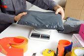 foto of argo  - Post Office worker weighs the parcel before sending - JPG