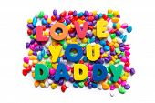 stock photo of daddy  - Love You Daddy colorful word on the colorful stones  - JPG
