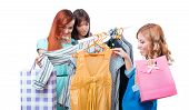stock photo of triplets  - Girlfriends in clothes store isolated on white - JPG