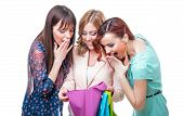 pic of triplets  - Surprised girl friends looking into shopping bag isolated on white background - JPG