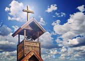 stock photo of heavenly  - An Old Church Bell Tower with Cross and Heavenly Light - JPG