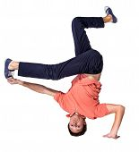 foto of break-dance  - Break dancer doing an one handed handstand against a white background - JPG