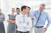 picture of congratulation  - Businessman congratulating his colleagues in office - JPG