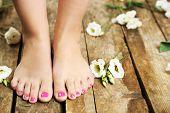 stock photo of fingers legs  - Beautiful female legs on rustic wooden floor background - JPG