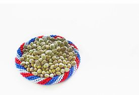 picture of seed bearing  - Hemp seeds in a bracelet of flag colours in a white background - JPG