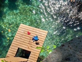 image of samoa  - A tourist swims off the diving platform in To Sua - JPG