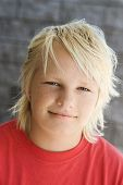 Head shot of Caucasian teen boy looking at viewer.