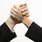 Close-up of hands of Caucasian man and woman arm wrestling.