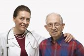 Mid-adult Caucasian female doctor with arm around elderly Caucasian male.