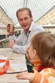 Father With Baby In Cafe
