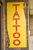 Tattoo sign outside of tattoo parlor.