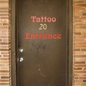 Doorway entrance to tattoo parlor.