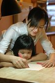 picture of niece  - teaching her niece how to write at home - JPG