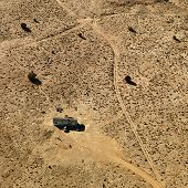 Aerial of trailer home in Arizona desert.