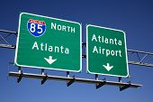 Freeway signs directing drivers to the Atlanta airport. Horizontal shot.