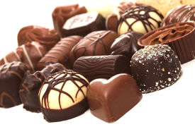 foto of heart shape  - a collection of mixed chocolates against a white background - JPG
