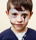 Little Cute Real Boy With Facepaint Like Zombie Apocalypse At Halloween Party Close Up, Treat Or Tre poster