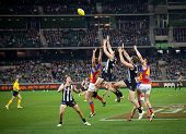 MELBOURNE - AUGUST 20 : Alex Fasolo (C) takes a strong mark during Collingwood's  win over Brisbane