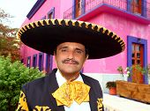 Charro mexican Mariachi man portrait in a pink Mexico house