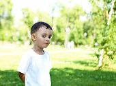 Portrait of a little boy in the park